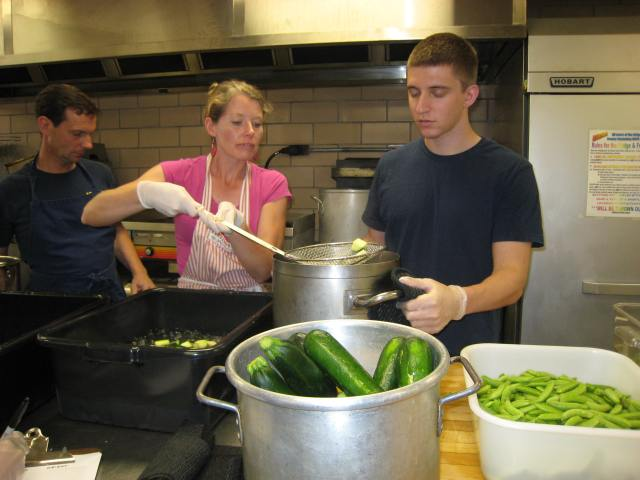 Volunteers processing food during the summer.