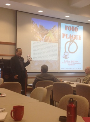 Dr. Andersen with a copy of his new book, Food Plague.